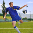 Soccer player shooting ball — Stock Photo