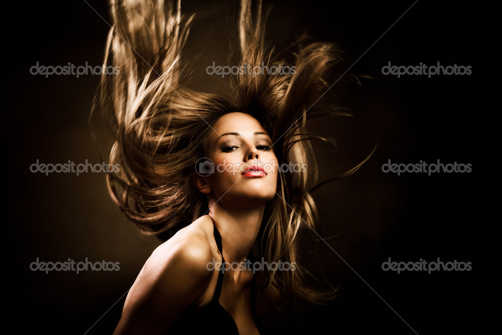 Beautiful woman with long golden hair in motion, studio shot — Photo #3964644