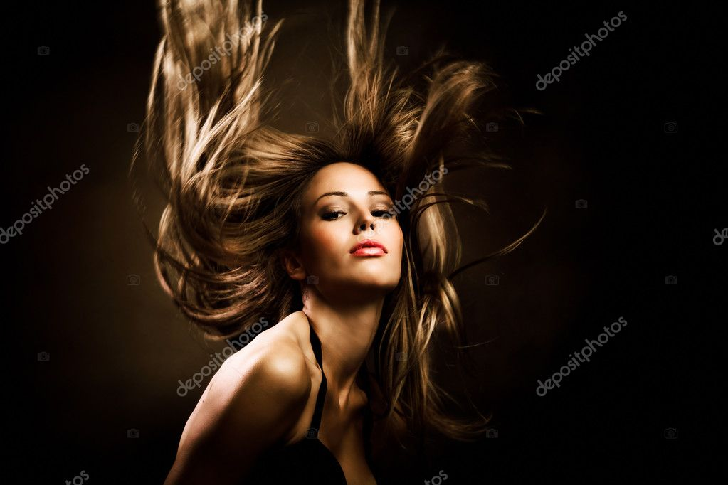 Beautiful woman with long golden hair in motion, studio shot — Lizenzfreies Foto #3964644