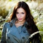 Woman in autumn meadow — Stock Photo #4004743