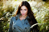 Woman in autumn meadow — Stock Photo