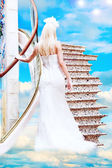 Bride on stairs to haven — Stock Photo