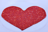 Freshly sliced sausage — Stock Photo