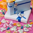 Wrapped presents with hearts — Stock Photo