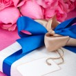 Romantic present with note - Stock Photo