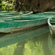 Wooden boats anchored on river (2) — Stock Photo