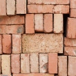 Nicely stacked pile of red bricks — Stock Photo
