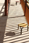 Chairs with shadow patterns — Stock Photo