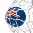 Royalty-Free Stock Photo: Australian soccer ball inside the net
