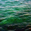 Flecks of sunlight on sea water - Stock Photo
