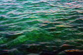 Flecks of sunlight on sea water — Stock Photo