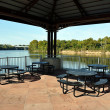 Picnic Tables on Pavilion Overlooking River — Stock Photo