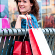 Stock Photo: Young Brunette Female Shopper Resting