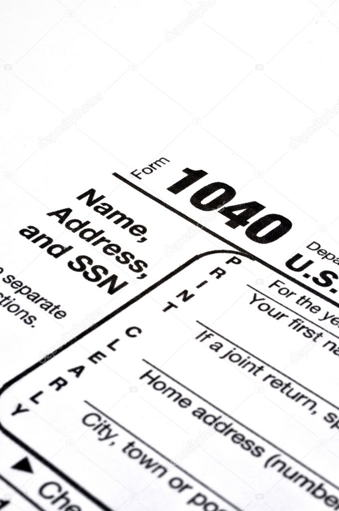 Closeup of IRS form 1040 on white background with ink pen and coffee. — Stock Photo #4906844