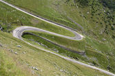 Curve on a high mountain road — Stock Photo