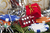 Dices, gift and chips for Christmas — Stock Photo