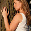 Woman and a tree — Stock Photo