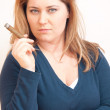 Woman is smoking — Stock Photo