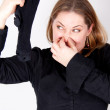 A woman is holding a smelly sock — Stock Photo #4595624