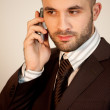 A man with suit uses a phone — Stock Photo