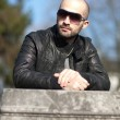 Young man with a leather jacket and sunglasses — Stock Photo #5134102
