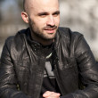 Young man with a leather jacket — Stock Photo #5134127