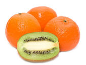 Kiwi and mandarines — Stock Photo