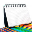 Notebook in a cell with pencils — Stock Photo #4148011