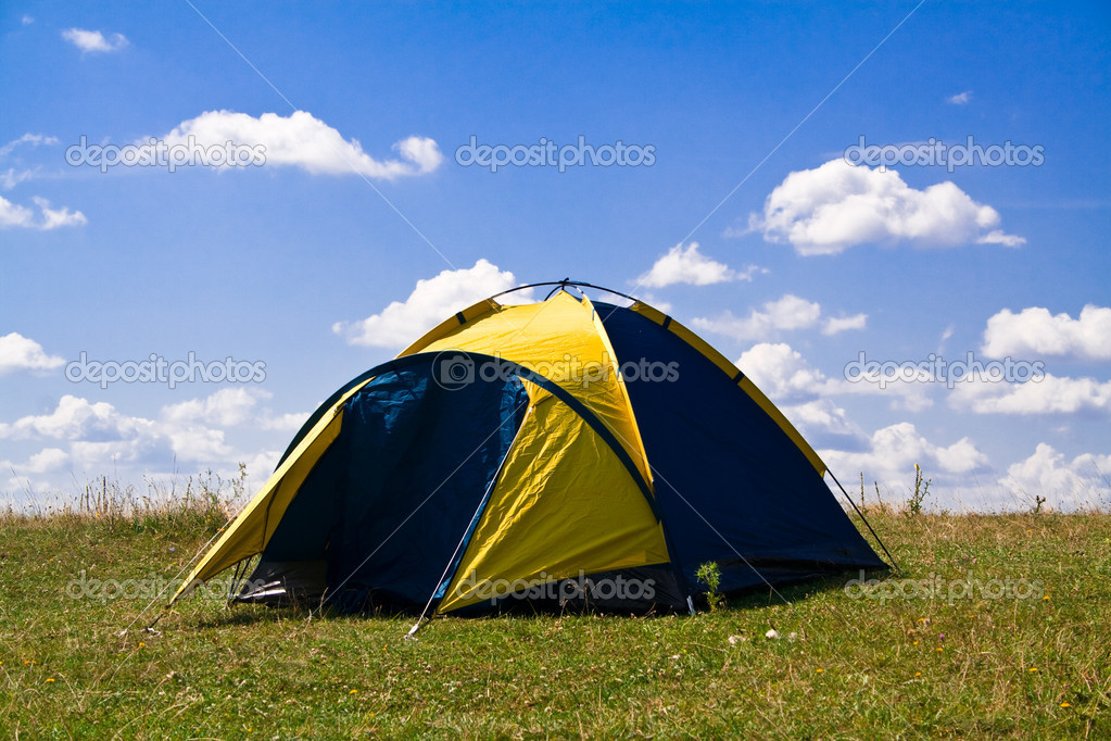 Tourist tent on nature on a background clouds — Stock Photo #4149233