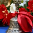 Bronze melodic bell with a red ribbon prom in college — Stock Photo