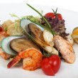 Delicatessen dish with tiger shrimps, mussels — Stock Photo