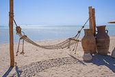 Hammock on a tropical beach — Стоковое фото