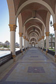 Arched walkway at a piazza — Stock Photo