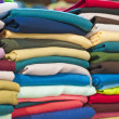 Stock Photo: Fabrics at a market stall