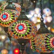 Ornate glass lights at a market stall — Foto Stock