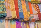 Fabrics at a market stall — Stock Photo