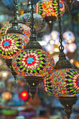 Ornate glass lights at a market stall — Stock Photo