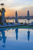 View from a hotel pool with sunset — Stock Photo