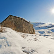 Mountain hut in the snow — Stok fotoğraf