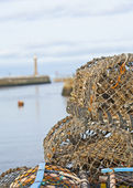 Lobster pots on a harbor quayside — Stock Photo