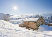 Isolated mountain hut in the sun — Stock Photo