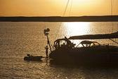 Large sailing yacht in sunset — Stock Photo