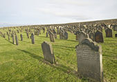 Old church cemetery with headstones — Stock Photo