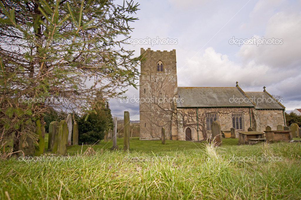 An old traditional village church in the english countryside  Stock Photo #5176784