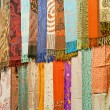 Fabrics at a market stall — Stockfoto