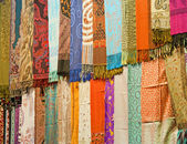 Fabrics at a market stall — Stock Photo
