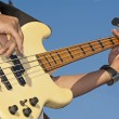 Bass guitarist playing live — 图库照片