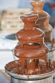 Chocolate fountain dessert — Stock Photo