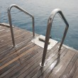 Metal railings on the back of a boat — Stok fotoğraf