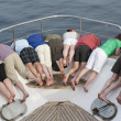 Group of looking over bow of a boat — Foto de Stock